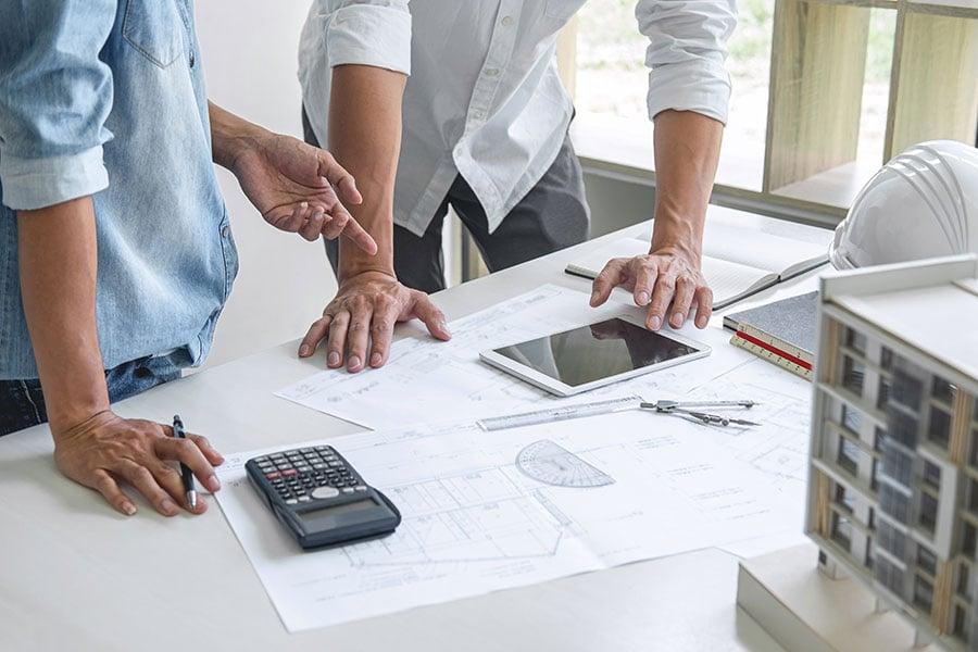 bigstock-Architecture-Engineer-Teamwork-328085461
