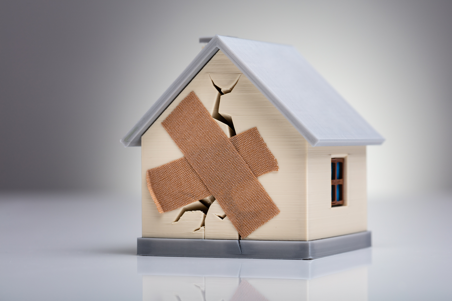bigstock-Broken-House-Model-With-Crosse-295067065