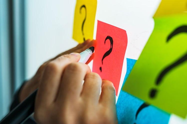 bigstock-Businesswoman-Writing-Question-294459541-1
