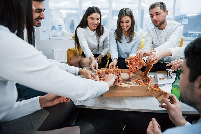 bigstock-Eating-Pizza-Celebrating-Succ-336906652