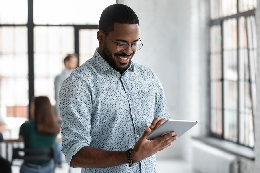 bigstock-Happy-Black-Male-Employee-Read-420642368
