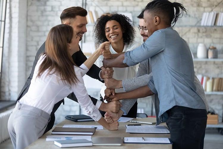 bigstock-Smiling-Diverse-Employees-Stac-359634859