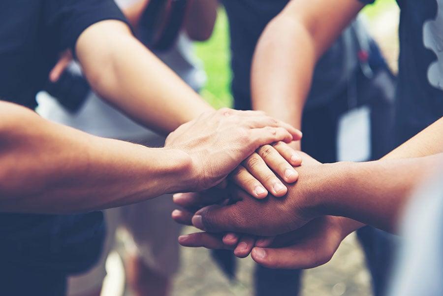 bigstock-Solidarity-Unite-People-Hands--381988193