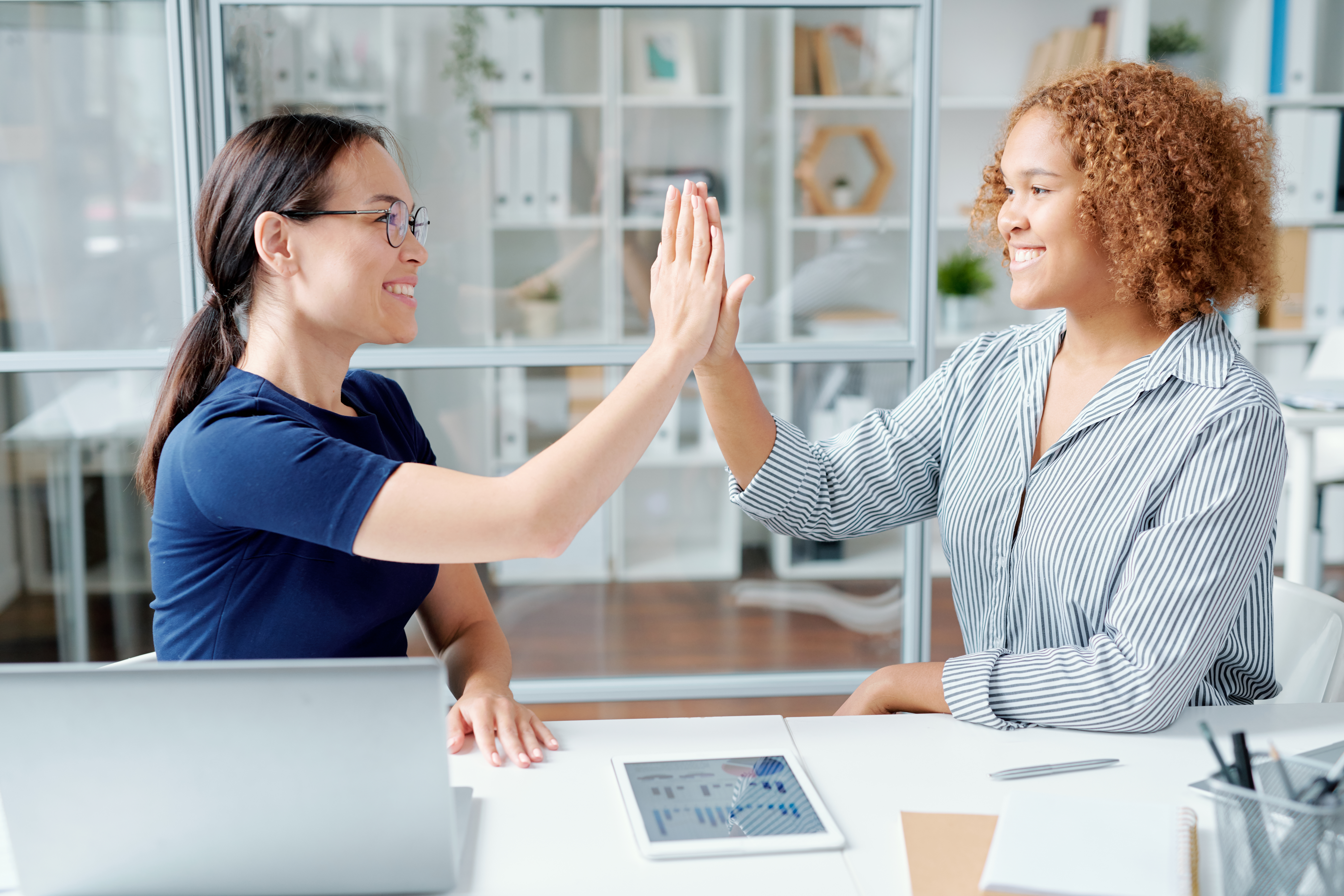 bigstock-Two-young-multicultural-office-321145285